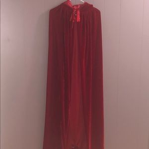Red velvet floor length hooded cape.